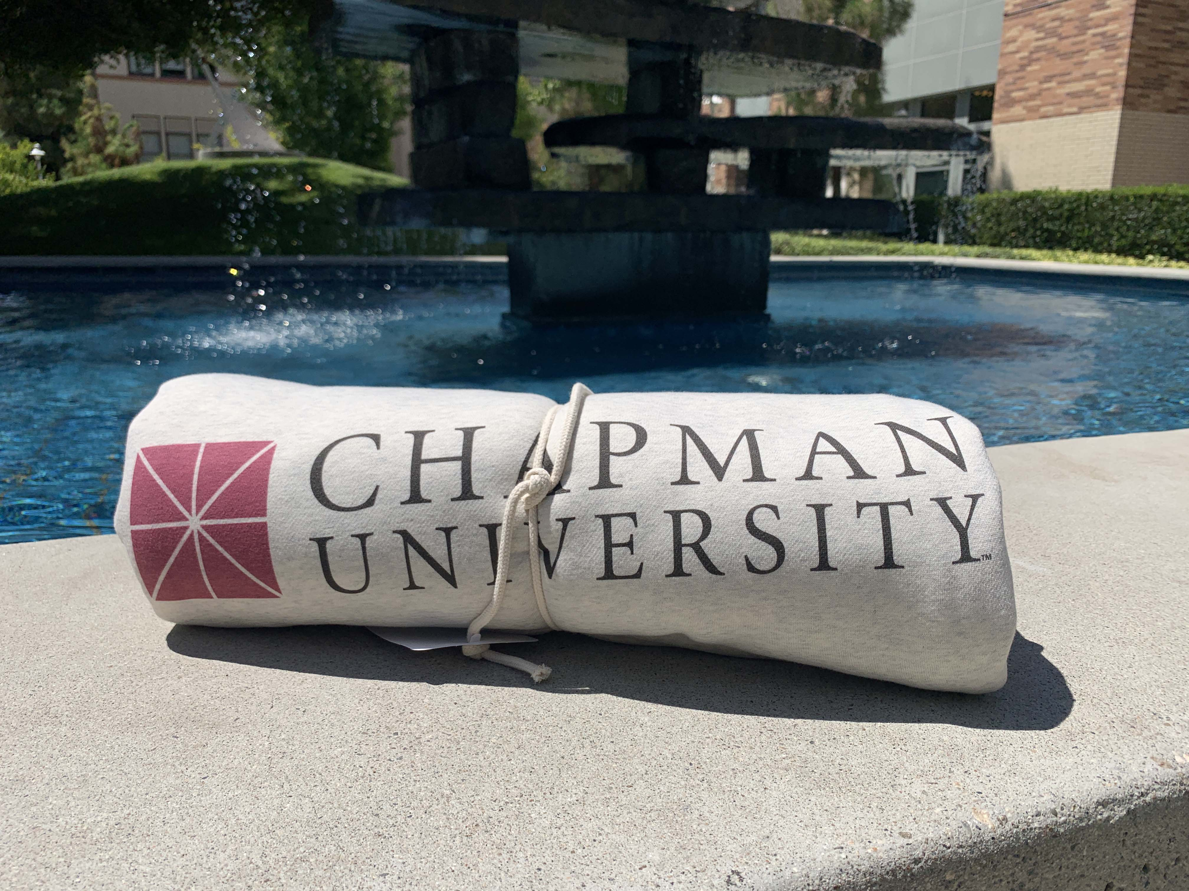 rolled up blanket with chapman university logo