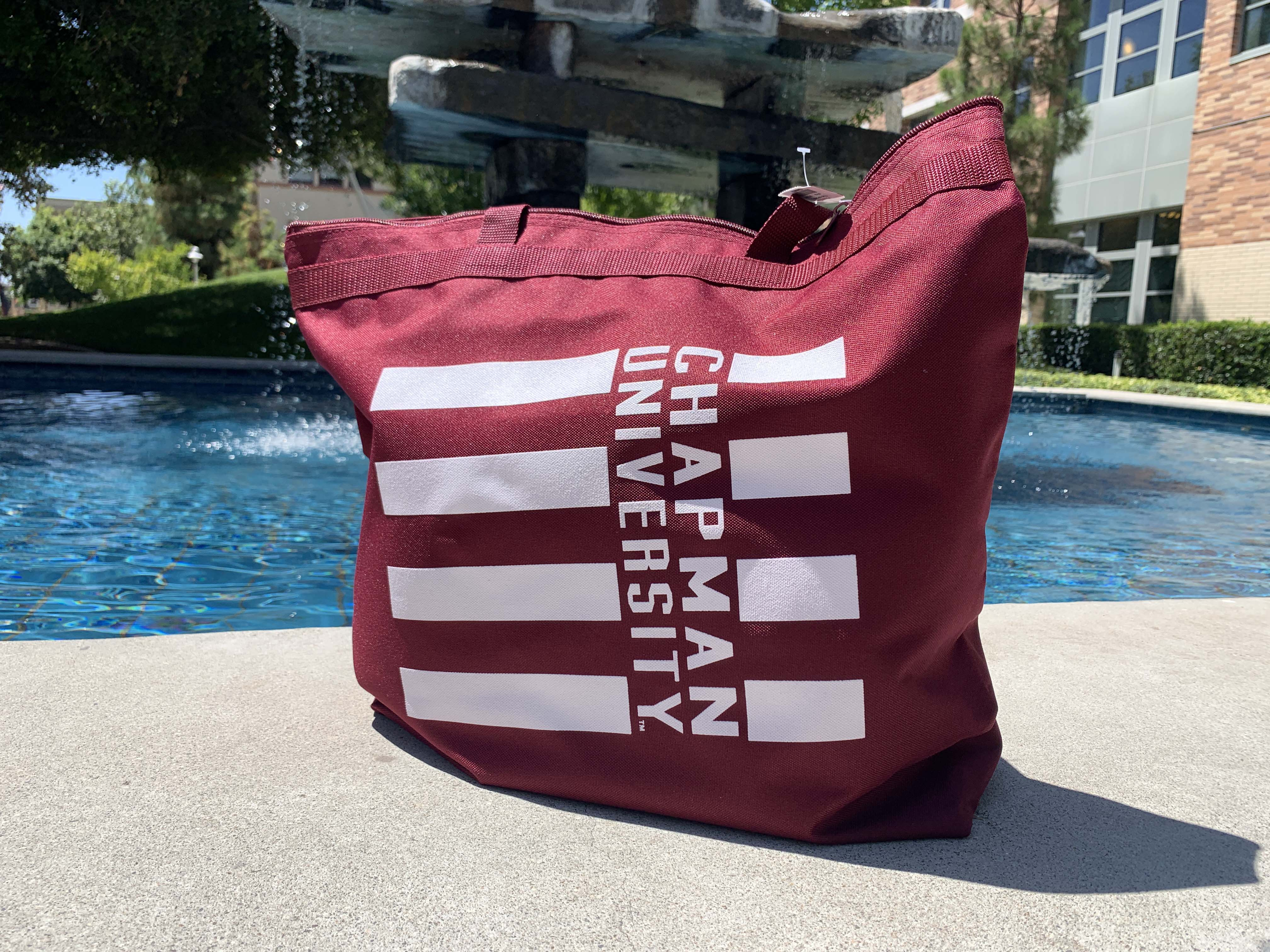red tote bag with Chapman University printed on the front