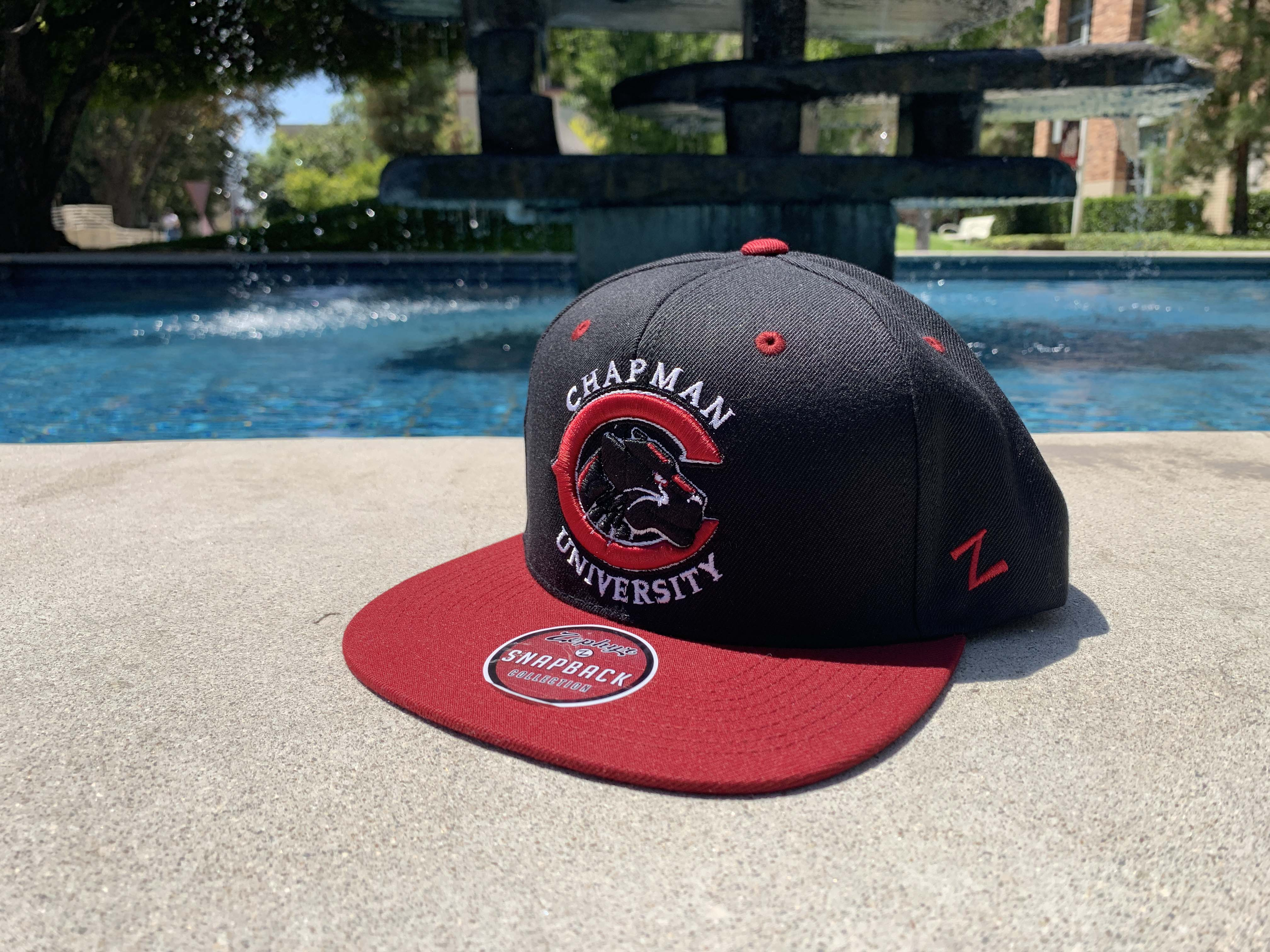black and red baseball cap with Chapman University panther logo